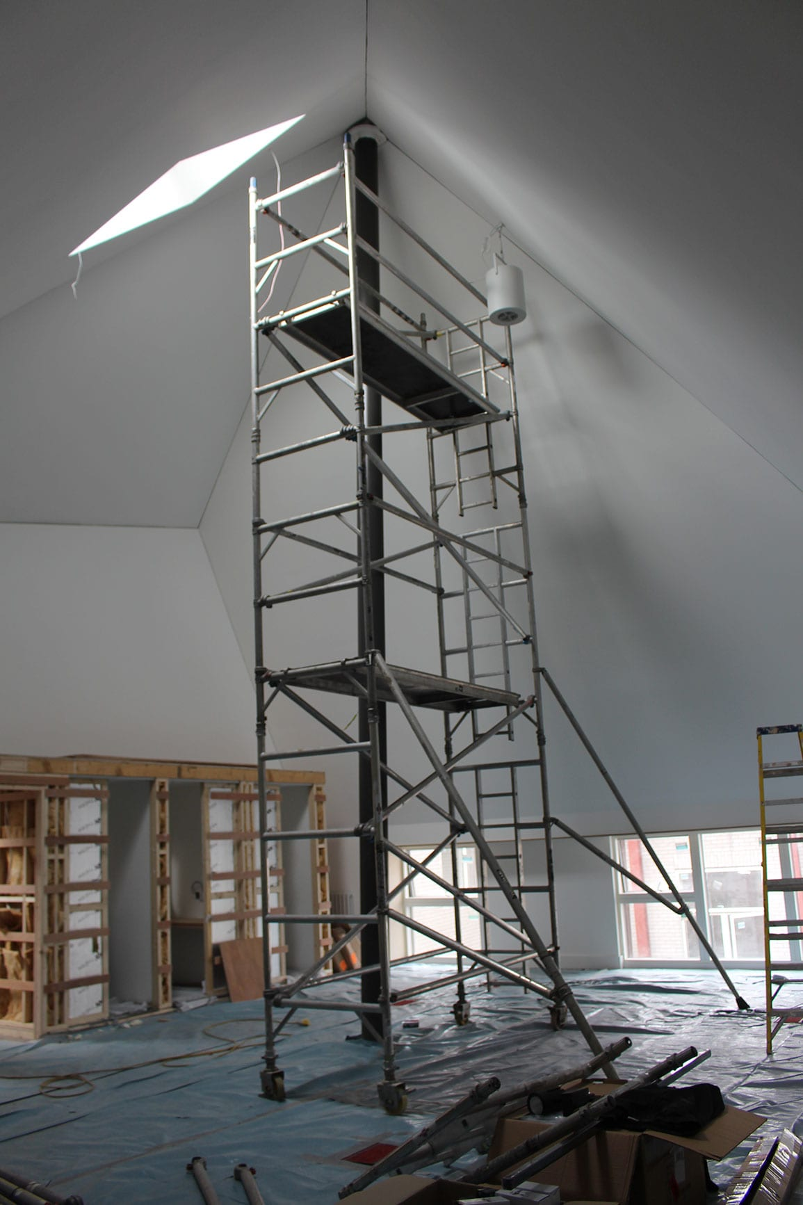 Architectural Emporium Walk the plank in progress site photo hub office pyramid roof